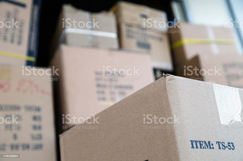 Pile of brown cardboard boxes at warehouse of market stock photo