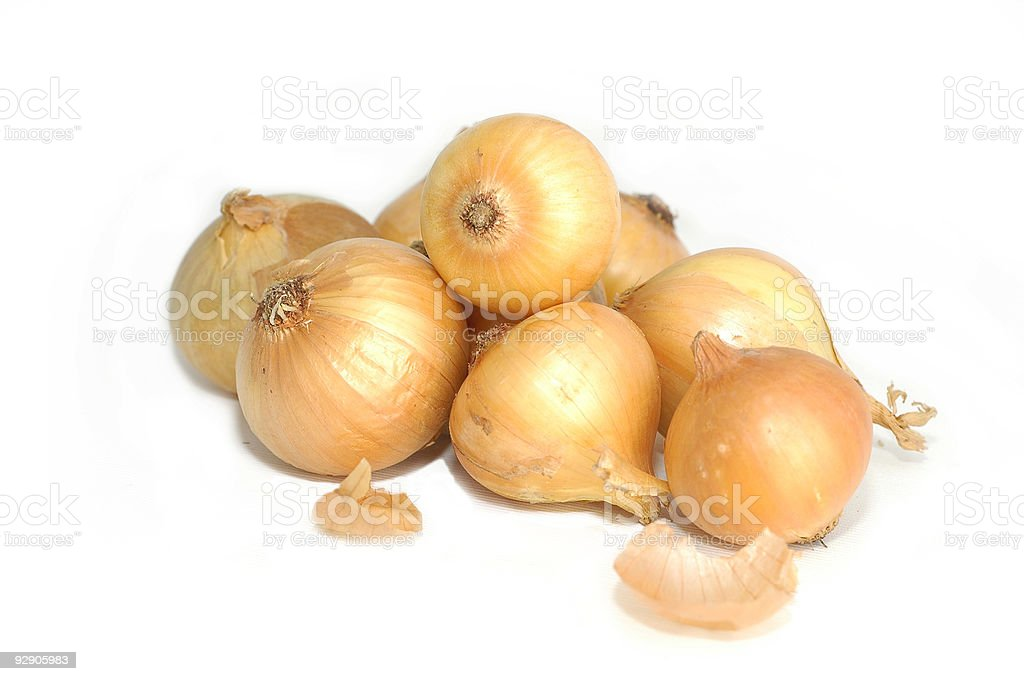 Pile of brown onions on white background stock photo