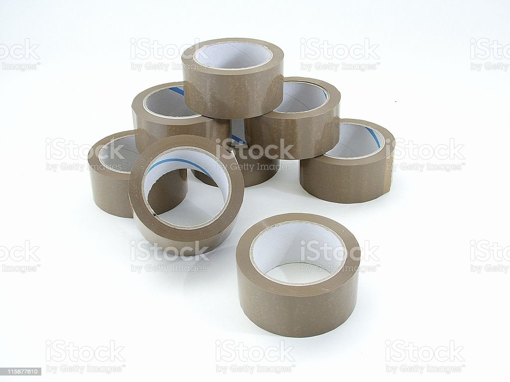 Pile of brown parcel tape rolls 2 royalty-free stock photo