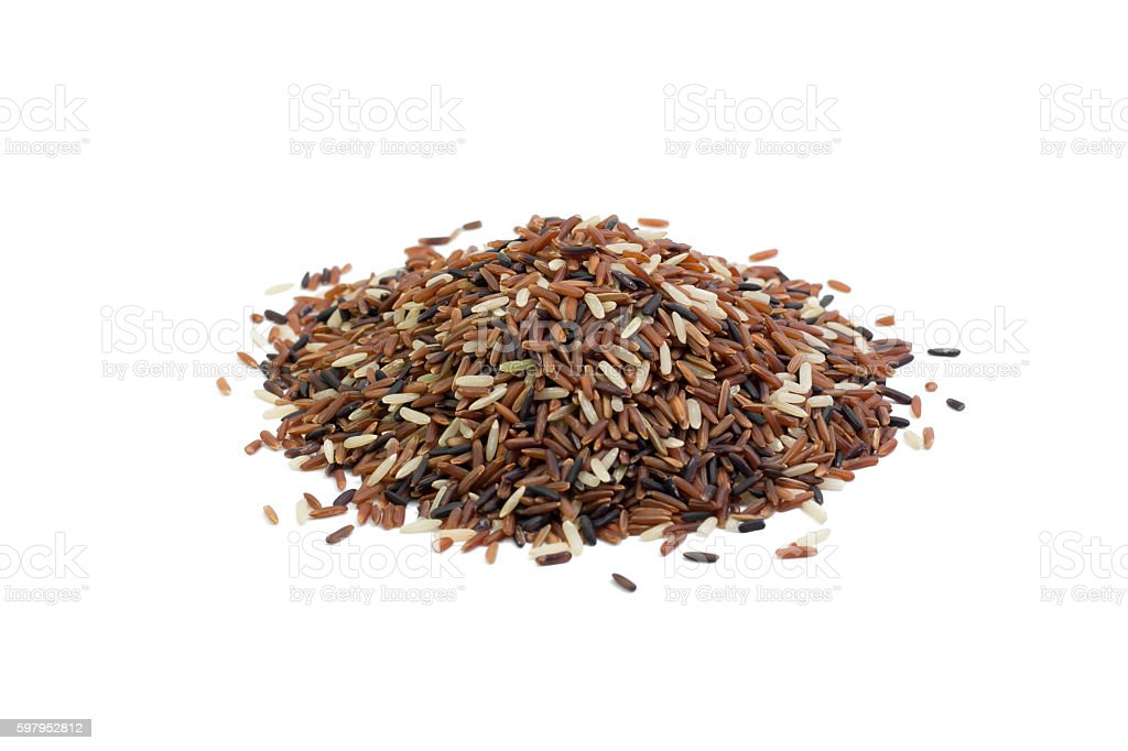pile of brown rice isolated on white stock photo