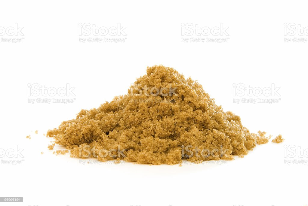 Pile of brown sugar on white royalty free stockfoto
