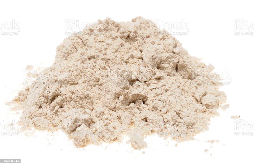 Pile of buckwheat flour on a white background stock photo