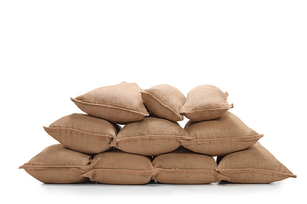 pile of burlap sacks - greppel stockfoto's en -beelden