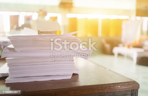 istock Pile of business documents on desk, Stack of business paper about application form document applying for job, registering claim for health insurance in workplace of Secretary,business office concept 1153850977