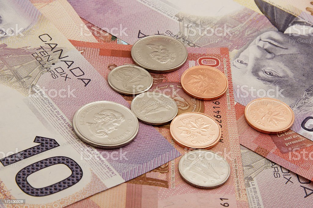 Pile of Canadian bills and coins stock photo
