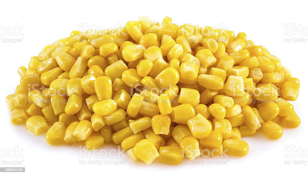 Pile of canned corn on white background stock photo