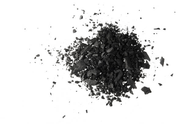 pile of carbon charcoal  dust isolated on white background - charcoal drawing stock photos and pictures