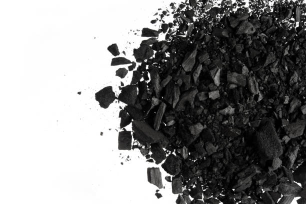 pile of carbon charcoal  dust on white background - charcoal drawing stock photos and pictures