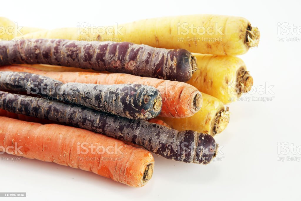 pile of carrots. Crate of mixed fresh harvested colorful carrot on...
