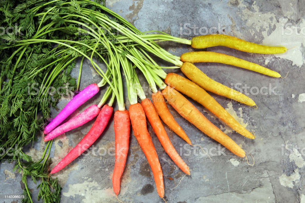 pile of carrots. Crate of mixed fresh harvested colorful carrot