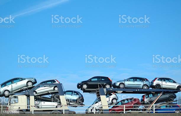 Car conveyer againgst blue sky on flyover.transport lightbox