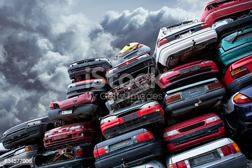 istock Pile of cars 634577006