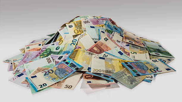 Pile of cash, heaps of money, side view stock photo