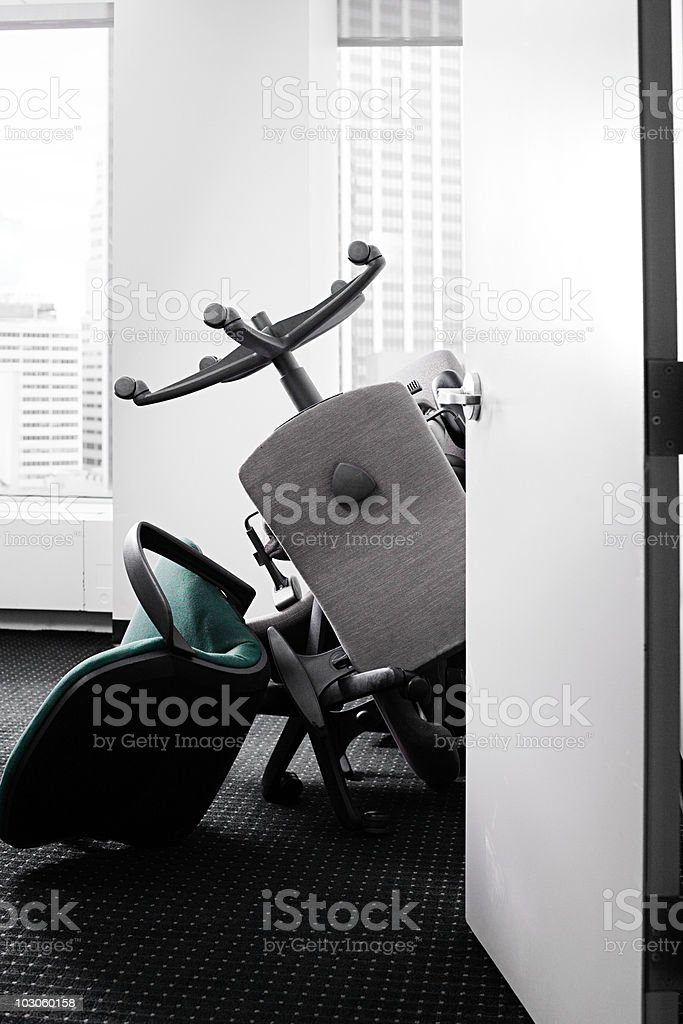 Pile of chairs in office royalty-free stock photo