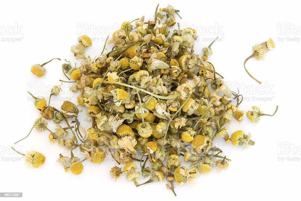 Pile of chamomile on white stock photo