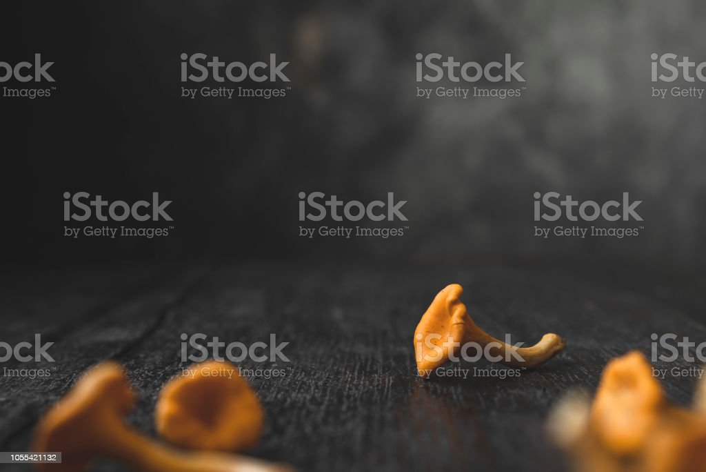 Pile of chanterelle mushrooms on a wooden table