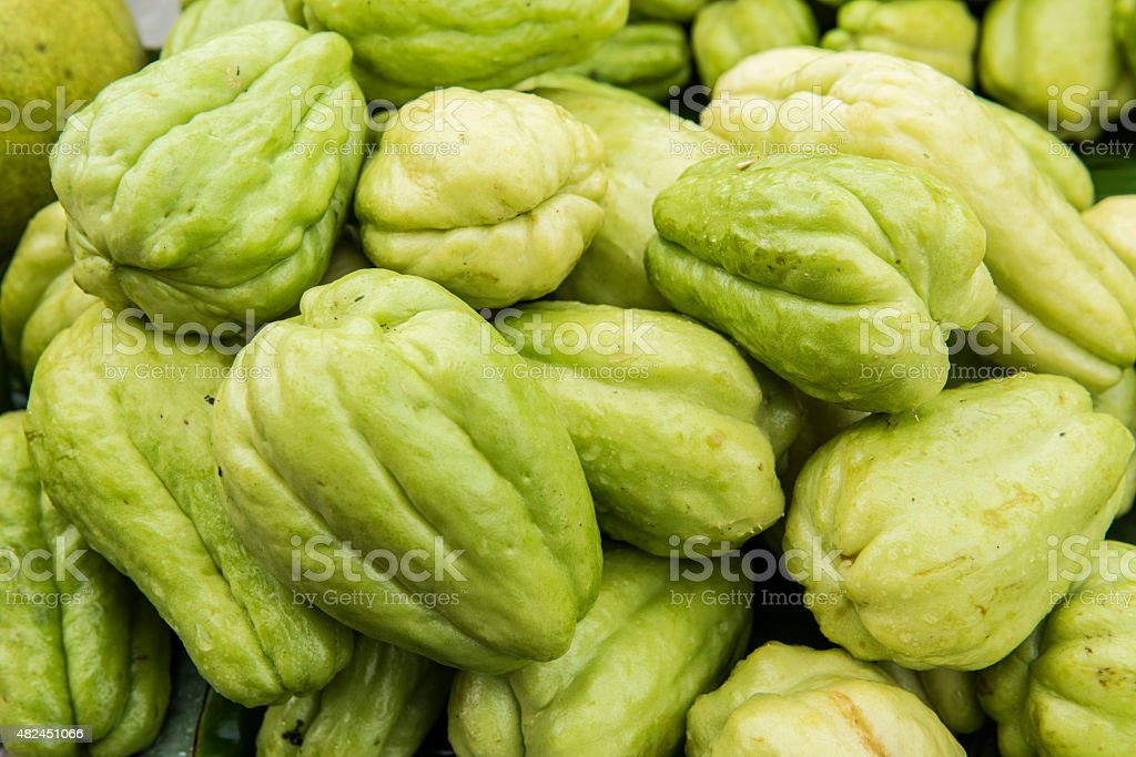 Pile of Chayote fruits for sale stock photo