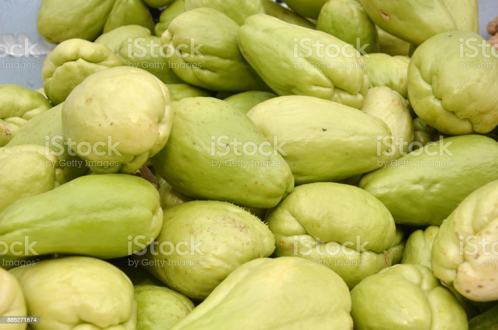 Pile of chayote fruits on local market stock photo