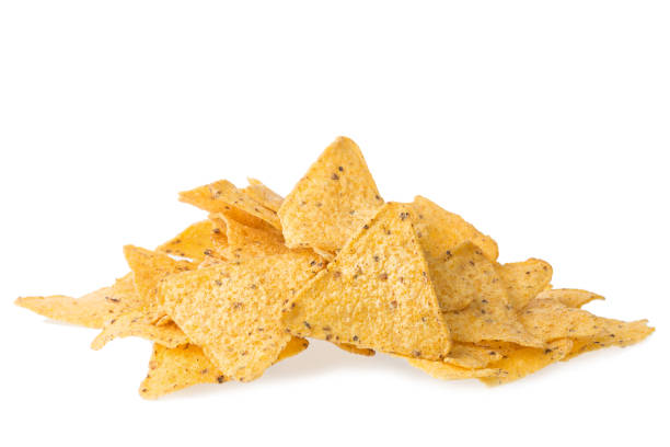 a pile of cheese covered tortilla chips isolated on white background. nachos mexican cuisine. - chipsy zdjęcia i obrazy z banku zdjęć