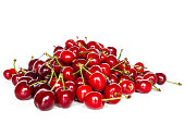 Front view of a pile of cherries on a white background. Spring fruit scene.
