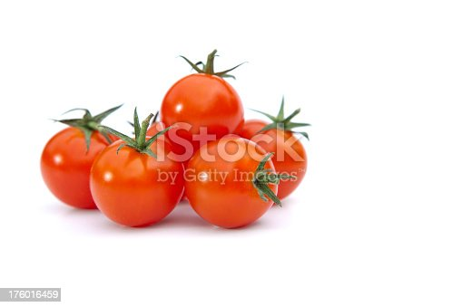 Small red tomatoes with stem. White background