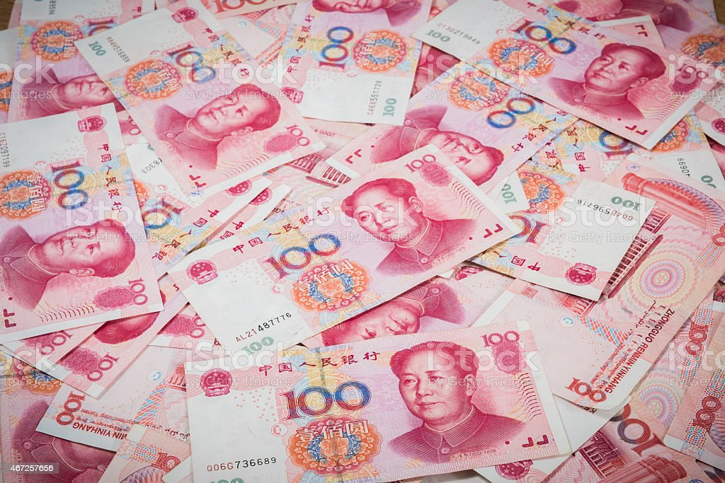 Pile of Chinese currency 100s of yuan  stock photo