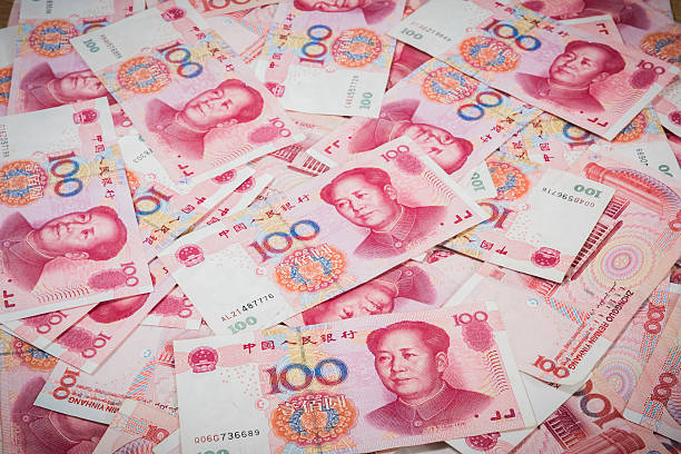 Pile of Chinese currency 100s of yuan  closeup 100 Yuan, Chinese money is background chinese currency stock pictures, royalty-free photos & images