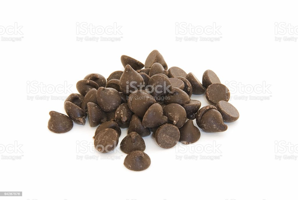 Pile of chocolate chips on white stock photo