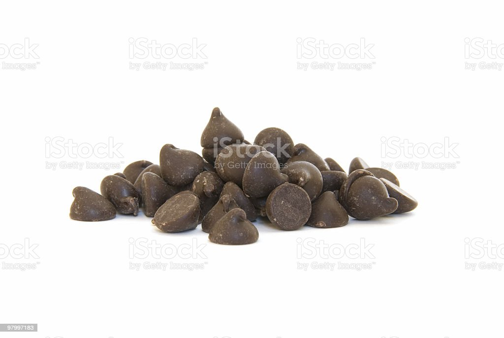Pile of chocolate chips on white royalty free stockfoto