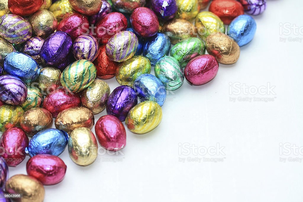 pile of chocolate eggs with copy space royalty-free stock photo