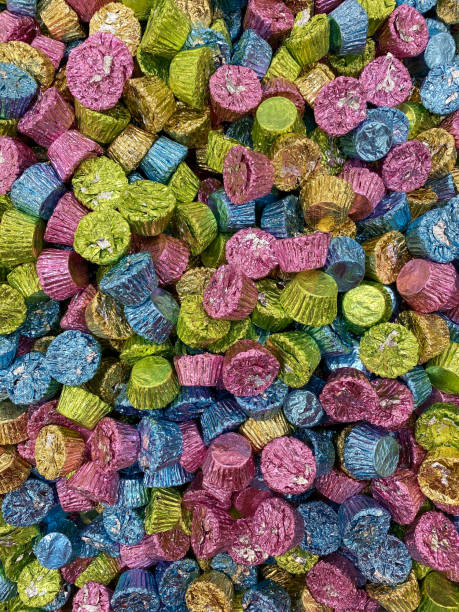pile of chocolate peanut butter candy treats in easter pastel green blue gold pink colors stock photo