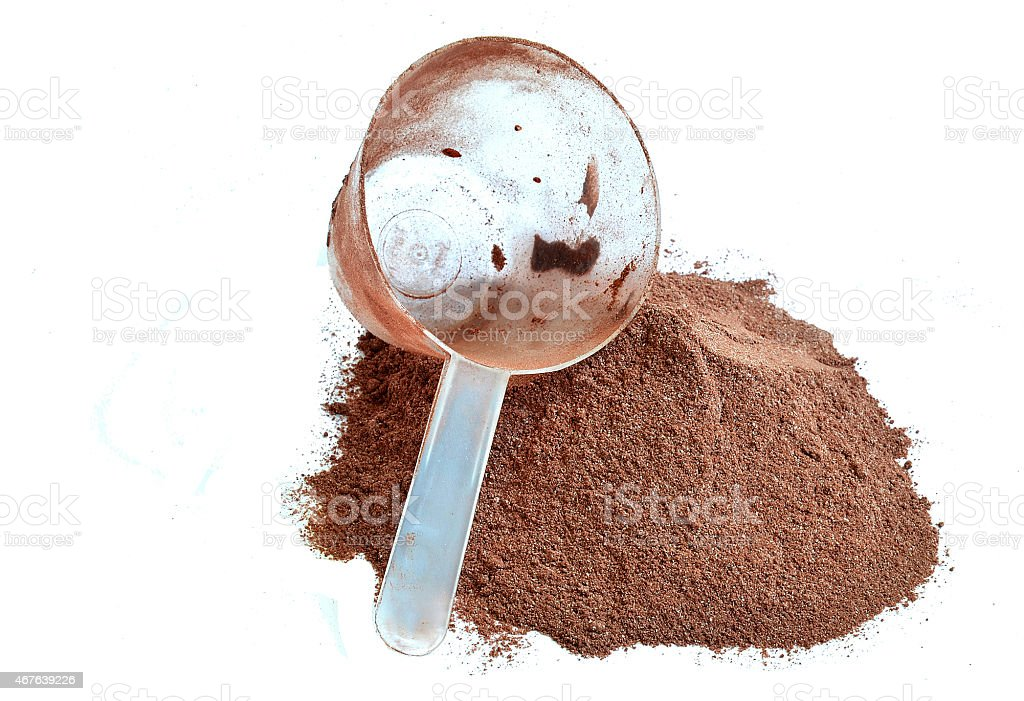 Pile of chocolate protein shake and scoop stock photo