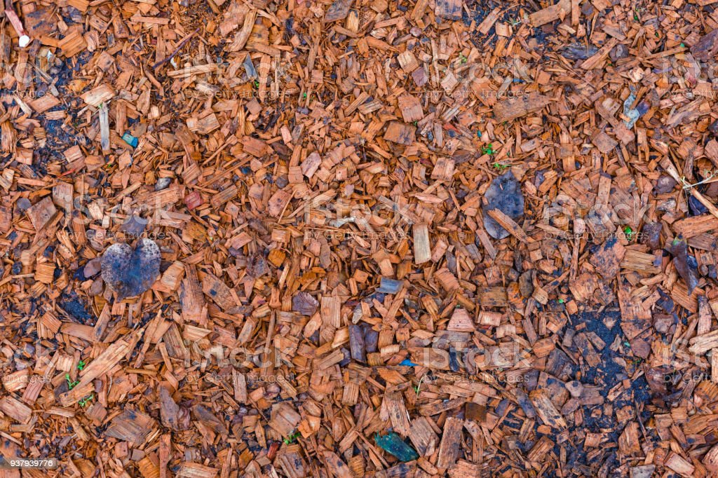 A pile of chopped wood background red wood pieces for flower bed stock photo