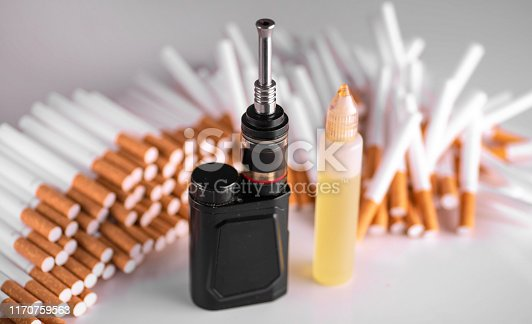 istock Pile of cigarettes and modern electronic cigarette. vape vs cigarettes 1170759563