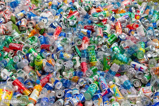 istock Pile of clear plastic bottle waste and beer cans on dump 1173155404