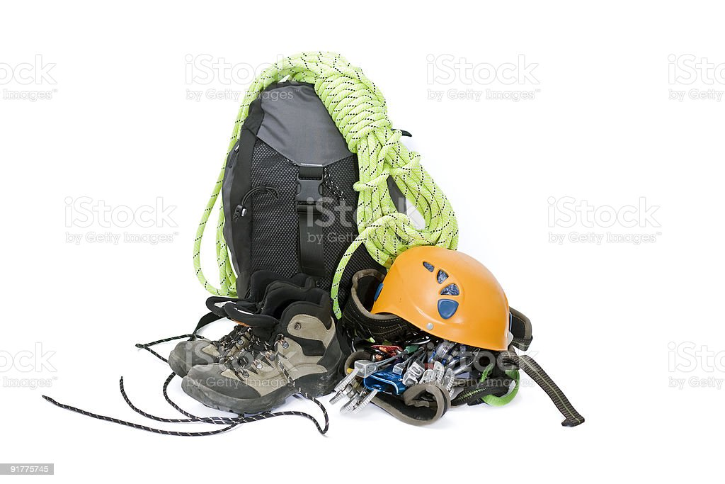A pile of climbing gear with a backpack and a helmet stock photo