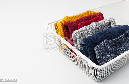 1164403364 istock photo A pile of clothes on white background 694535886