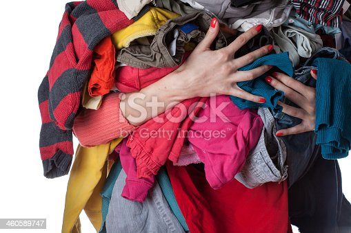 460589747istockphoto Pile of clothes 460589747