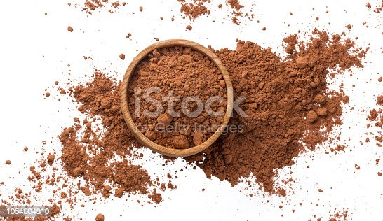 Cacao. Pile of cocoa powder in wooden bowl isolated on white background, top view