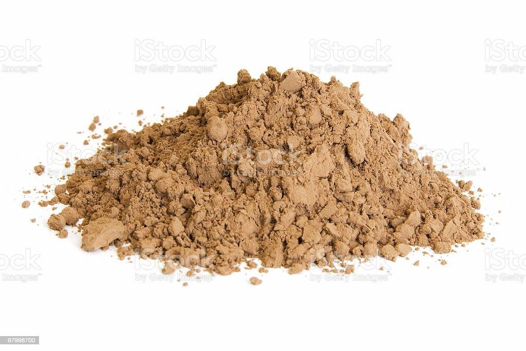 Pile of cocoa powder on white royalty free stockfoto