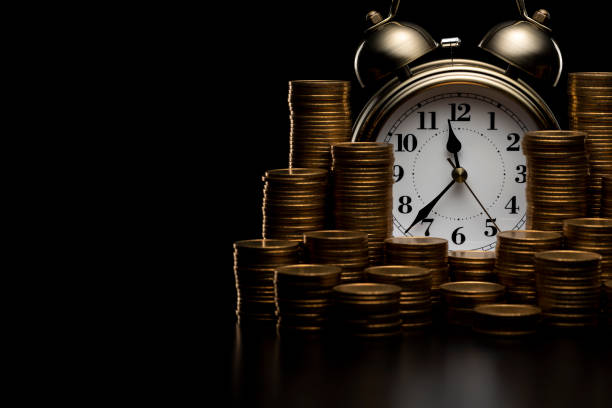 Pile of coins and alarm clock. Pile of coins and alarm clock. time is money stock pictures, royalty-free photos & images
