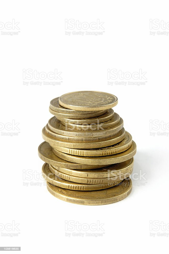 Pile of coins isolated on white royalty-free stock photo