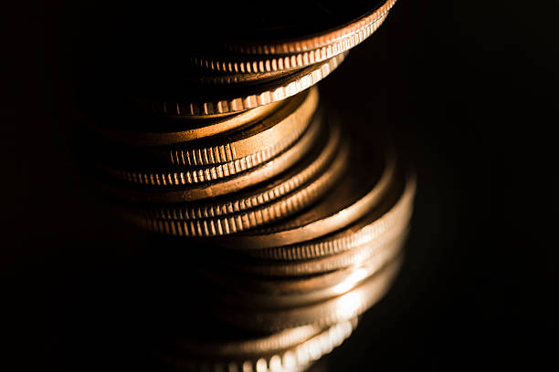 pile of coins on black - money black background stock photos and pictures