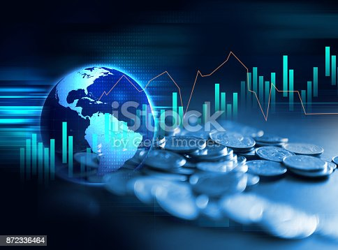 istock pile of coins on technology financial graph background. 872336464