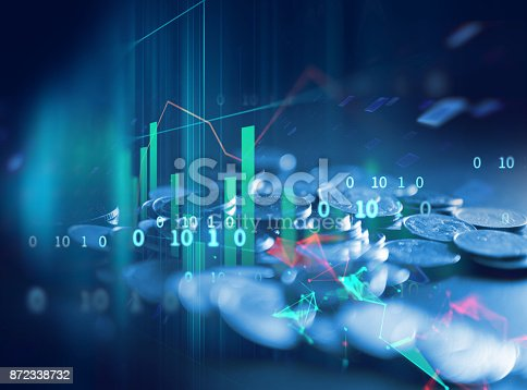 istock pile of coins on technology financial graph background. 872338732