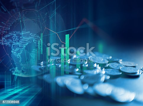 istock pile of coins on technology financial graph background. 872338948