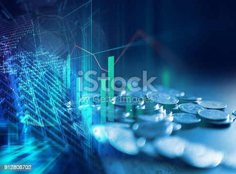 istock pile of coins on technology financial graph background. 912808702