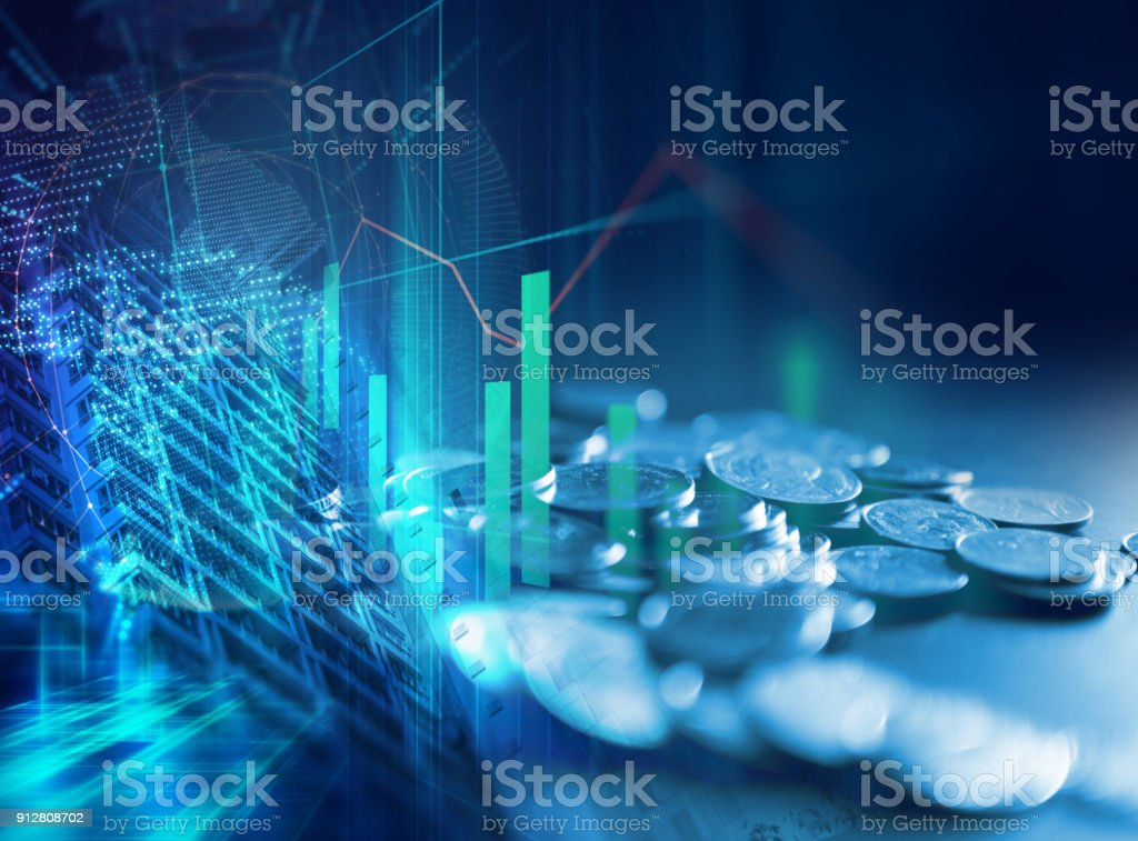 pile of coins on technology financial graph background. stock photo
