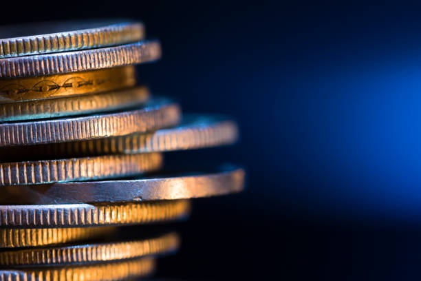 pile of coins - coin stock photos and pictures