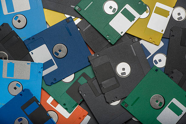 pile of color floppy disks - datenspeicher diskette stock-fotos und bilder